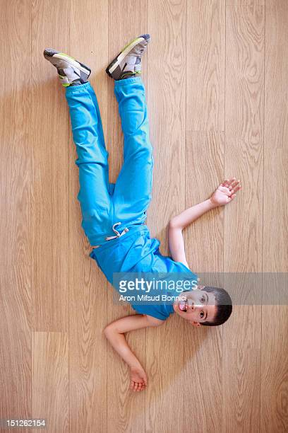 Boy lying on floor