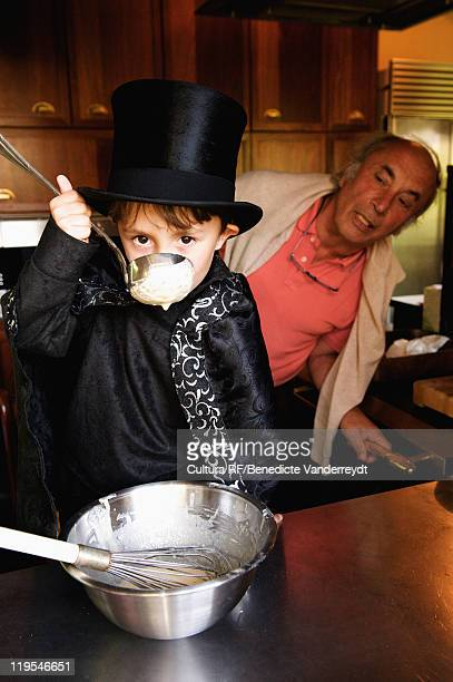 Boy magician tasting his cooking