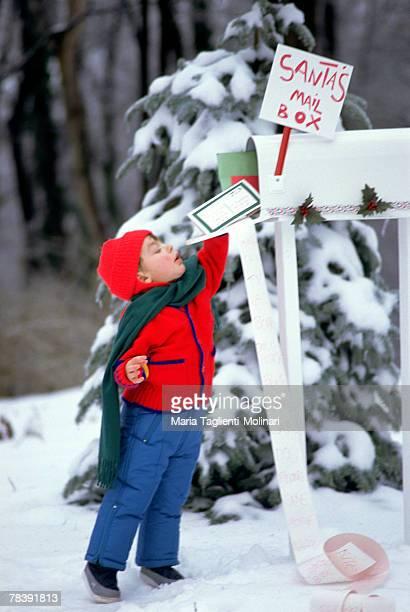 Boy mailing Christmas wish list