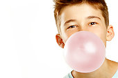 boy make bubble with chew on white background
