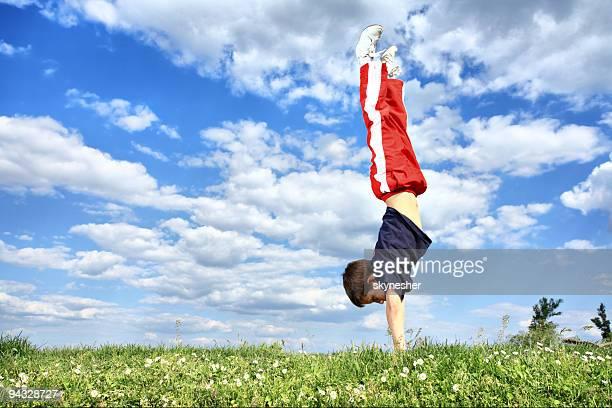 Boy makes a handstand