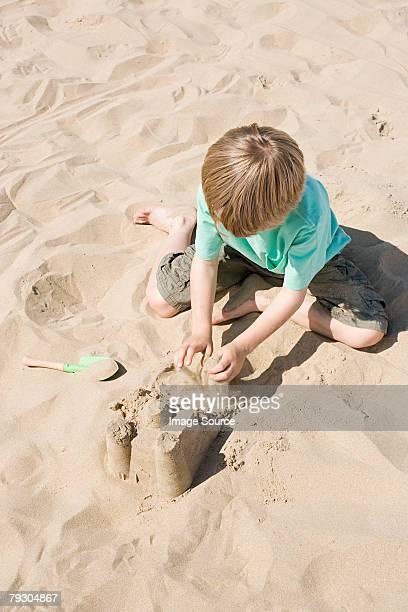 A boy making a sandcastle