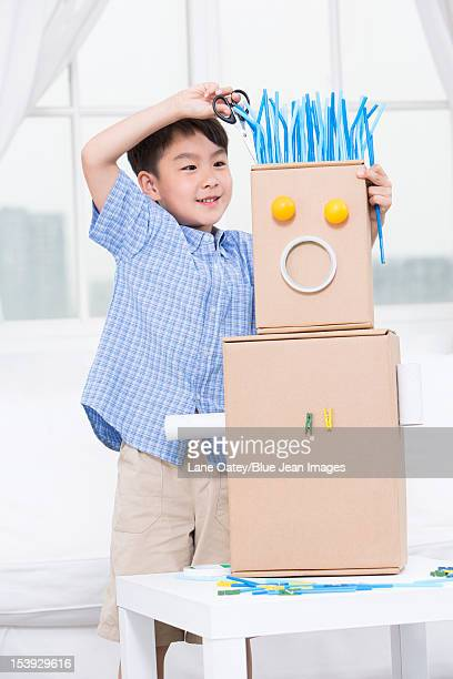 Boy making a toy robot