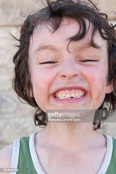 Boy making face at camera, portrait