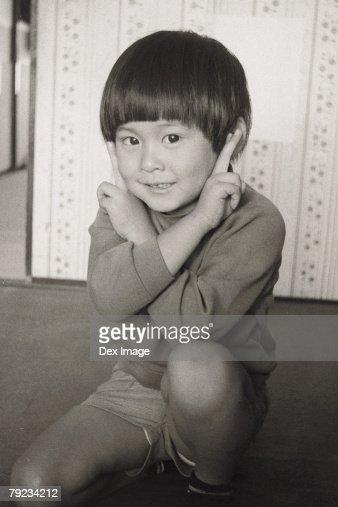 Boy making money face : Stock Photo