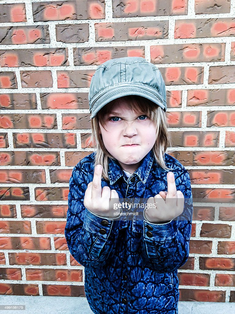 Boy (6-7) giving finger gesture