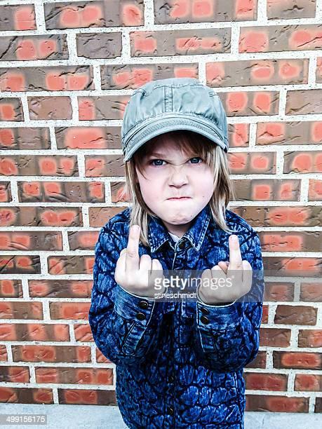 Boy making obscene gesture