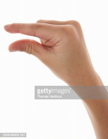 Boy (5-7) making pinching gesture, close-up of hand : Stock Photo