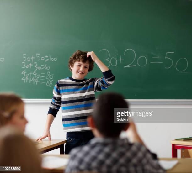 Boy making presentation in classroom