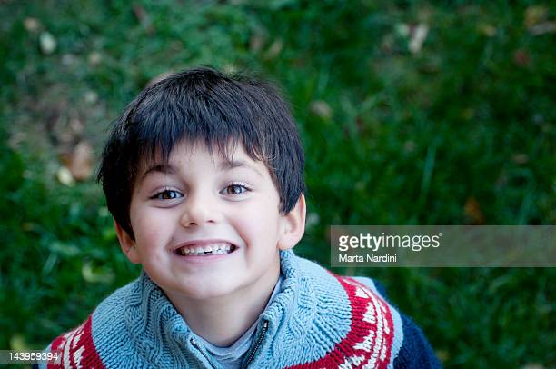Boy missing tooth smiling