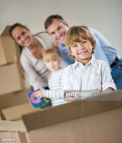 Boy moving house with his family