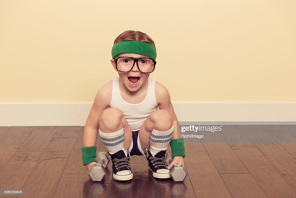 Boy Nerd Lifting Weights