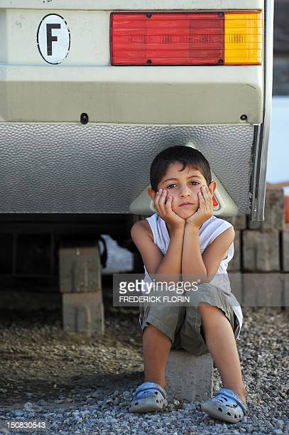 A boy of the Roma community is pictured in a camp of caravans called 'Area16' on August 27 2012 in Strasbourg eastern France The 'Area 16' in...