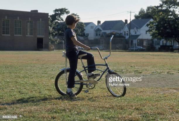 A boy on a chopper bicycle USA circa 1975