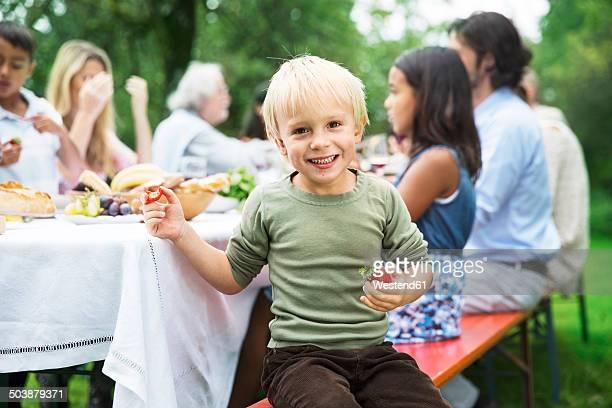 Boy on a garden party