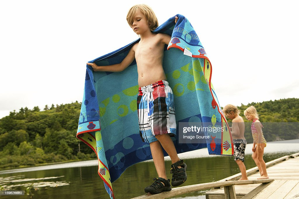 Boy on a pier with towel