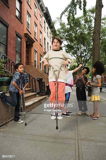 Boy on a pogo stick