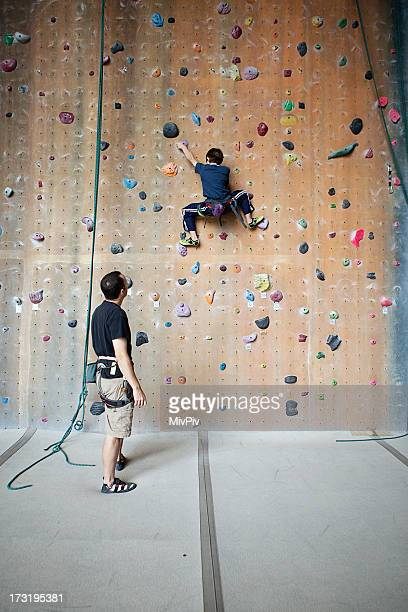Boy on a rock climbing wall