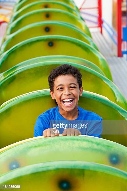 Boy on a roller coaster