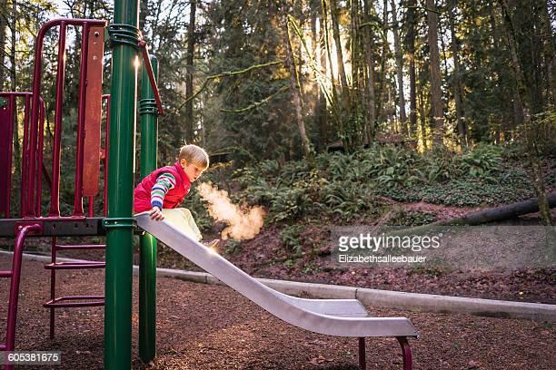 Boy on a slide in park