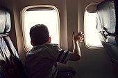 Boy on airplane