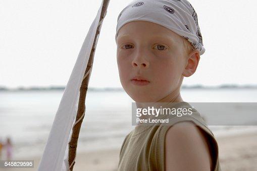 Boy on Beach Holding White Flag