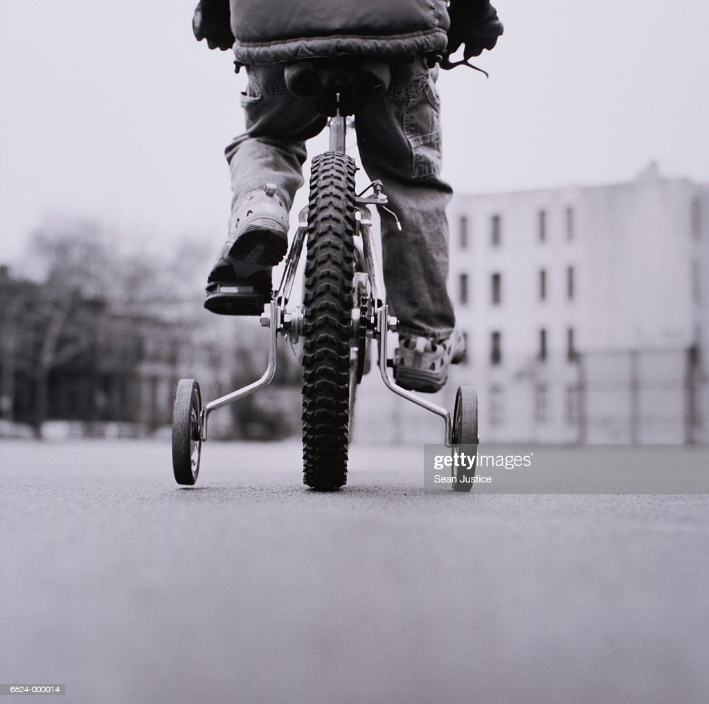 Boy on Bicycle with Stabilizer : Stock Photo