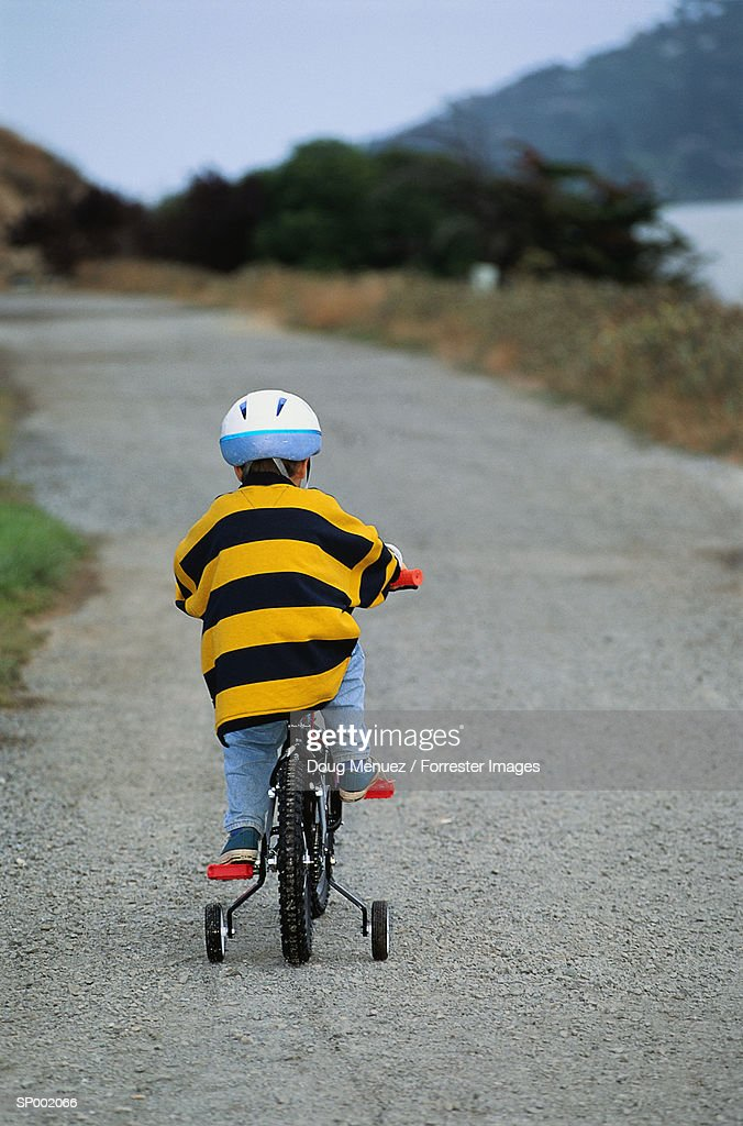 Boy on Bicycle  with Training Wheels : Stock Photo