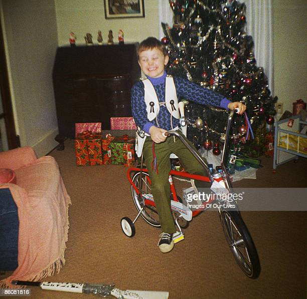 Boy on bike by Christmas tree