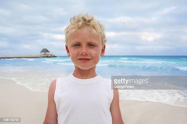 Boy on Caribbean Beach with Sunburn