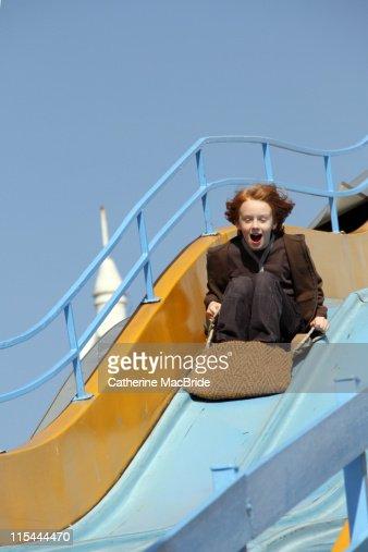 Boy On Fairground Slide Stock Photo