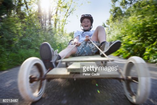 boy on go-kart in country lane : Stock Photo