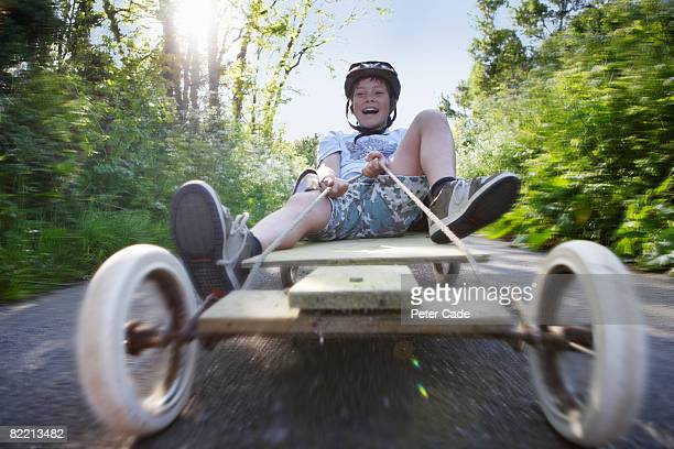 boy on go-kart in country lane