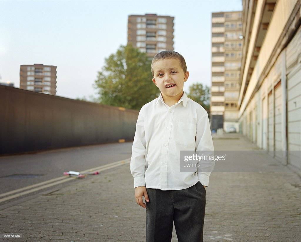 Boy on housing estate, portrait : Stock Photo