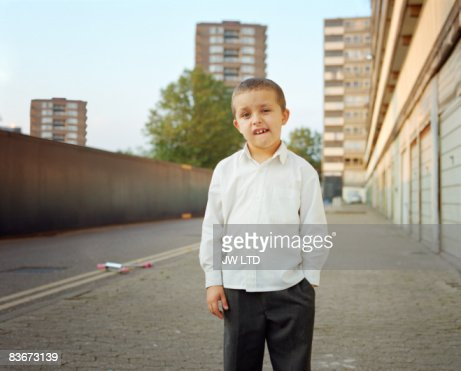 Boy on housing estate, portrait : Stock Photo