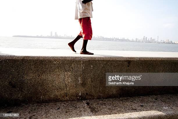 Boy on Mumbais Marine Drive