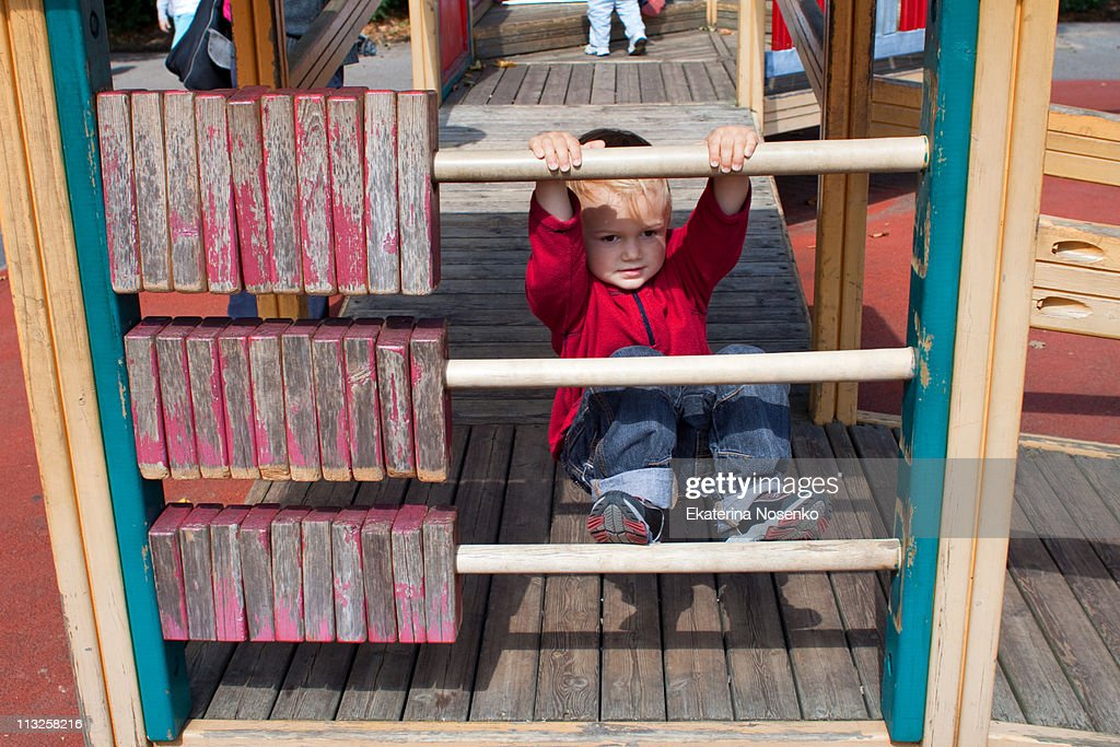 Boy on playground : Stock Photo
