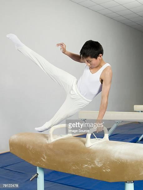 Boy on pommel horse