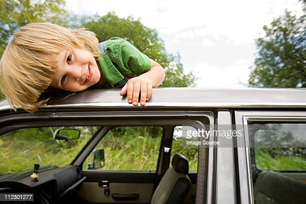 Boy on roof of car
