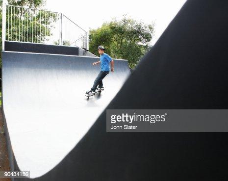 boy on skate board on half-pipe