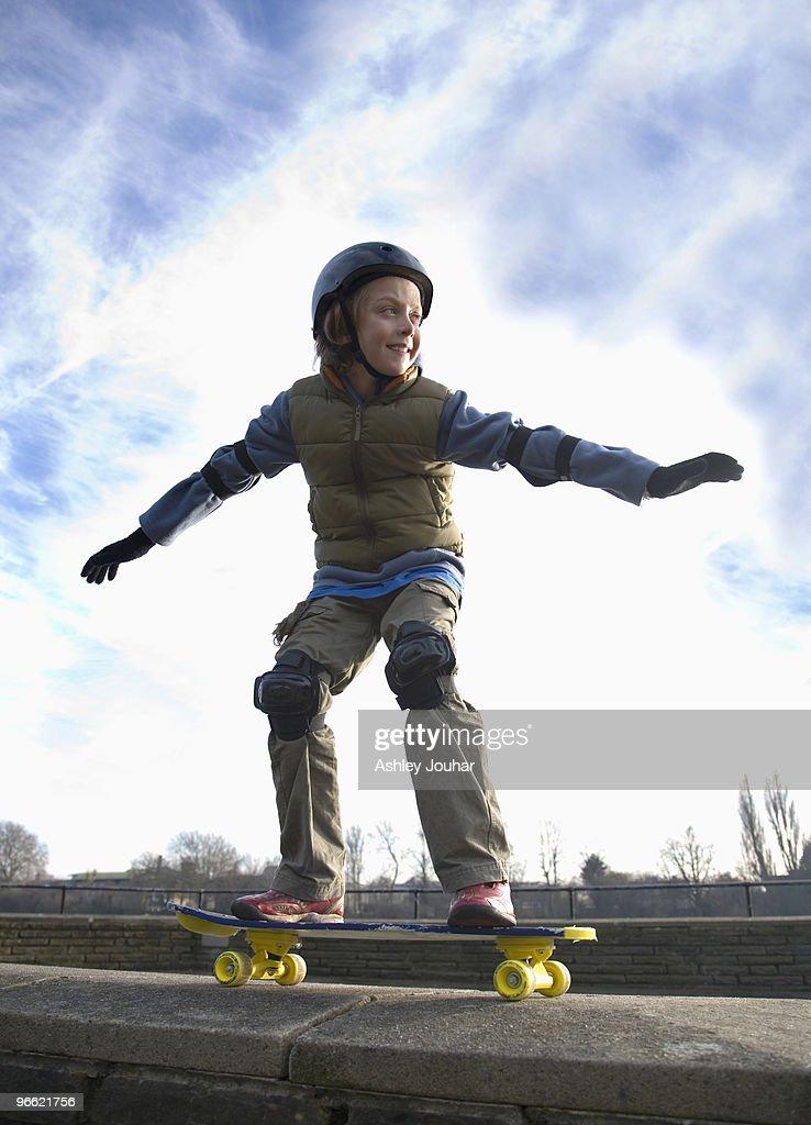 Boy (9-11) on skateboard : Stock Photo