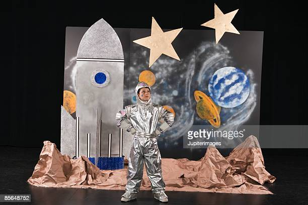 Boy on stage dressed in astronaut costume