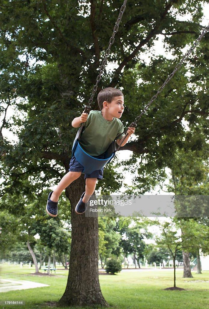Boy on Swing : Stock Photo