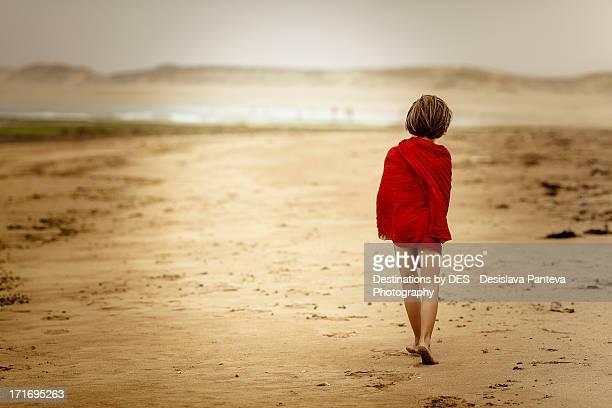 Boy on the beach alone