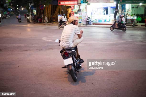 Boy on the motorcycle, Cat Ba island, Vietnam.
