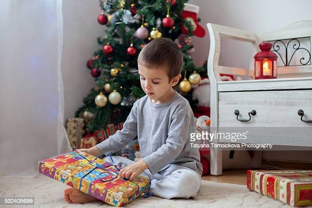 Boy, opening present on Christmas