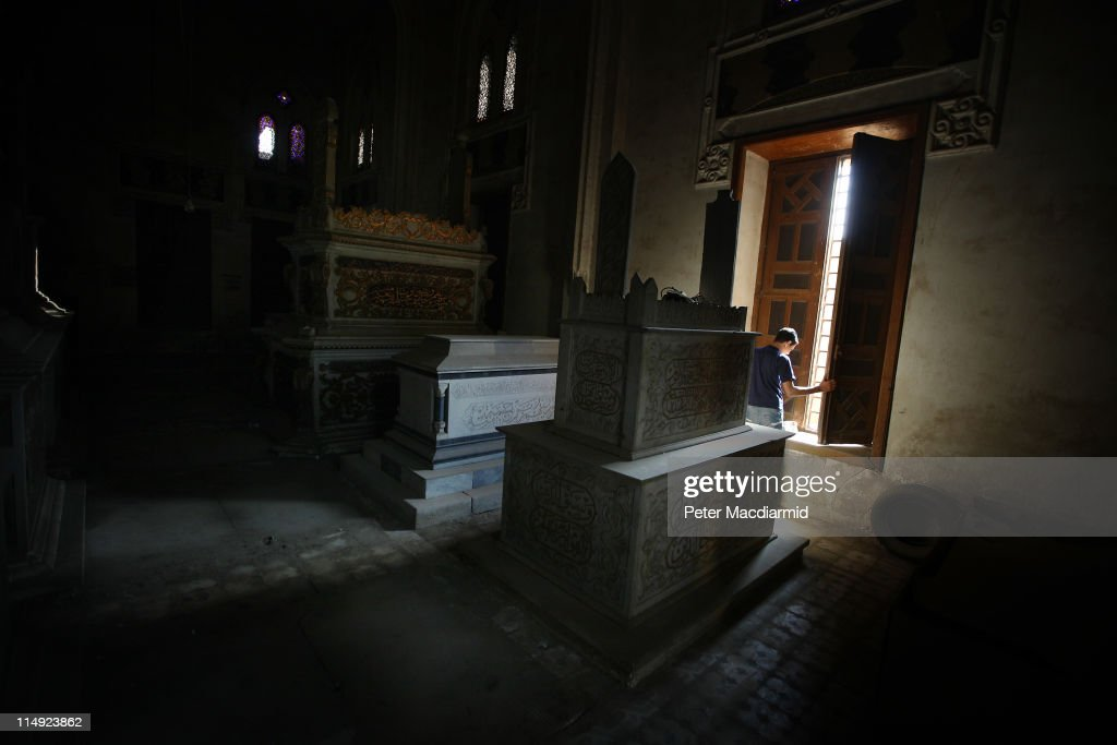 A boy opens the window of tomb containing the bodies of his father's wealthy former employers, in the City of the Dead on May 29, 2011 in Cairo, Egypt. It is thought that at least 500,000 people live among the tombs in two vast cemeteries know as the Cities of the Dead near the Citadel of Cairo. Protests in January and February brought an end to 30 years of autocratic rule by President Hosni Mubarak, who will now face trial. Food prices have doubled and youth unemployment stands at 30%. Tourism is yet to return to pre-uprising levels.