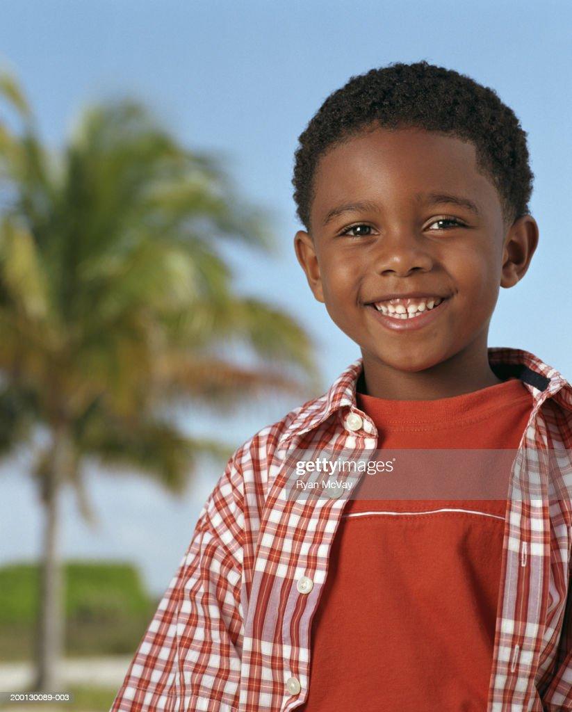 Boy (4-6) outdoors, portrait : Stock Photo
