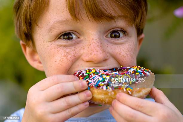 Boy Over Eating Chocolate Donut, Child Snacking on Unhealthy Food