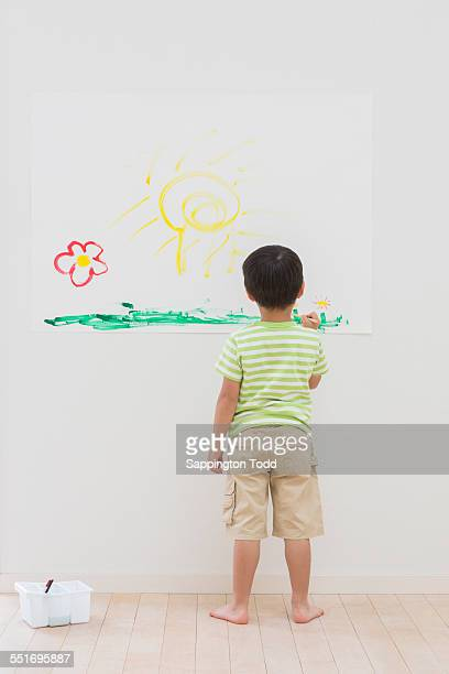 Boy Painting On Paper